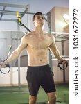muscular sportsman exercising... | Shutterstock . vector #1031672272