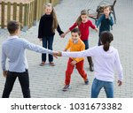 group of glad children playing... | Shutterstock . vector #1031673382