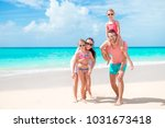 happy beautiful family on... | Shutterstock . vector #1031673418