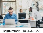 intern at the office working on ... | Shutterstock . vector #1031683222