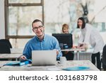 intern at the office working on ... | Shutterstock . vector #1031683798