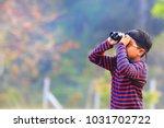 One Little Boy Use Binoculars...