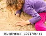 adorable little girl with curly ... | Shutterstock . vector #1031706466