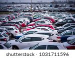cars for sale stock lot row.... | Shutterstock . vector #1031711596