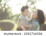 mother playing with son  in the ... | Shutterstock . vector #1031716336
