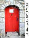 wooden retro red door with free ... | Shutterstock . vector #1031720176