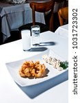 calamari with garlic sauce and... | Shutterstock . vector #1031723302