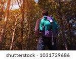 male backpacker travel trekking ... | Shutterstock . vector #1031729686