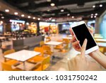 hand holding mobile phone with... | Shutterstock . vector #1031750242