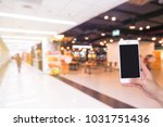 hand holding mobile phone with... | Shutterstock . vector #1031751436
