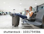 young female passenger at the... | Shutterstock . vector #1031754586