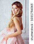 Stock photo portrait of beautiful smiling spring girl in a pink dress incredible blonde woman with long hair 1031756065