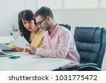 colleagues working at office | Shutterstock . vector #1031775472