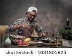 handsome bearded cheef cook... | Shutterstock . vector #1031805625