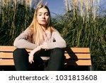 confident attractive blonde... | Shutterstock . vector #1031813608