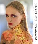 girl with blond hair  golden... | Shutterstock . vector #1031815768