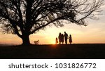 silhouettes of happy family... | Shutterstock . vector #1031826772