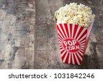 popcorn inside the packaging... | Shutterstock . vector #1031842246