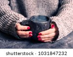 female hands warm up hands on a ... | Shutterstock . vector #1031847232