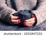 female hands warm up hands on a ... | Shutterstock . vector #1031847232