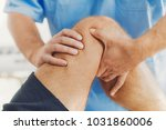 physiotherapist doing healing... | Shutterstock . vector #1031860006