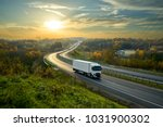 white truck driving on the...   Shutterstock . vector #1031900302