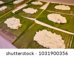 Small photo of Tamale preparation Mexican recipe with banana leaves and cornmeal