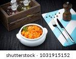 stewed cabbage bigos on black... | Shutterstock . vector #1031915152