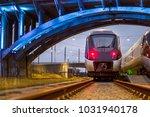 train paring under lit bridge   Shutterstock . vector #1031940178