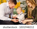 the little boy looks at the... | Shutterstock . vector #1031948212
