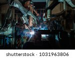 industrial welding robots are... | Shutterstock . vector #1031963806