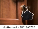 symbol of the house and stick... | Shutterstock . vector #1031968702