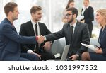 partners concluding deal and... | Shutterstock . vector #1031997352