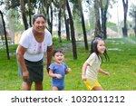 happy latin family   mother... | Shutterstock . vector #1032011212