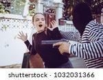 robbery with a firearm secretly ...   Shutterstock . vector #1032031366