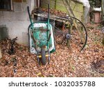 Rusty Wheelbarrow In A...
