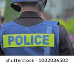 police stand behind.   Shutterstock . vector #1032036502