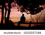 a lone man sitting in nature... | Shutterstock . vector #1032037186
