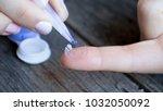 contact lens on finger on... | Shutterstock . vector #1032050092