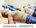 girl doing yoga in the hall | Shutterstock . vector #1032056722