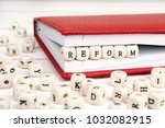 word reform written in wooden... | Shutterstock . vector #1032082915