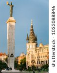 Small photo of Batumi, Adjara, Georgia. Statue Of Medea On Blue Sky Background In Europe Square. Woman Holding Golden Fleece. In Greek Mythology, Medea Was Daughter Of King Aeetes Of Colchis And Wife To Hero Jason