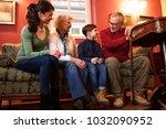 happy family visiting... | Shutterstock . vector #1032090952