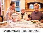 nice careful nurse sets a table ... | Shutterstock . vector #1032090958