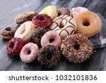 assorted donuts with chocolate... | Shutterstock . vector #1032101836