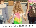 rear view of three girls'... | Shutterstock . vector #1032111916