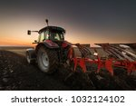 pouring corn grain into tractor ... | Shutterstock . vector #1032124102