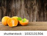 stack of orange fruit on old... | Shutterstock . vector #1032131506