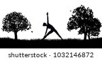 A woman in silhouette exercising by doing yoga or pilates in the park