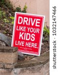 "Small photo of TIBURON, CALIFORNIA - JANUARY 17, 2018: Sign with warning text ""Drive like your kids live here"" alerting all drivers to be alert for children playing."